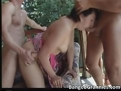 Nasty brunette milf blows stiff cock while pounded hard