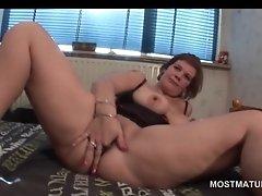 Attractive mature babe teasing her bald craving twat