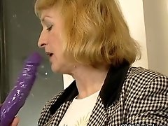 Nasty old woman goes crazy rubbing a dildo on her cunt
