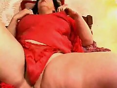 Kinky Granny making her own orgasms at home