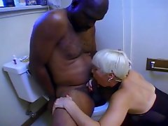 Black guy gets oral and fucks mature blonde in the toilet