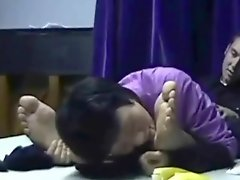 Chinese milf worships male feet