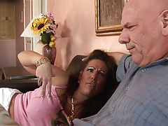 Hungry MILF with huge tits rides dude's thick cock on the sofa