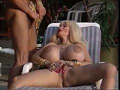 Blonde with very big tits and two guys