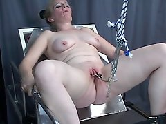 BDSM loving young slut gets her pussy clipped and filled with a hook