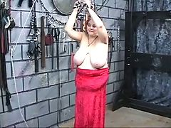 Heavy titted fat bdsm brunette gets caned and whipped by master