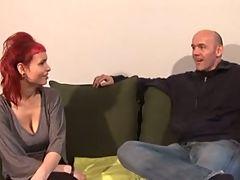 Natural busty redhead fucks on the sofa with boyfriend