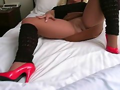 Hot Cougar Smoking in Heels Nylons and Leather Skirt