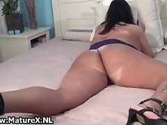 Old mom with a huge ass is stripping and playing with h