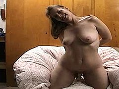 Housewife doing a video for her hubby