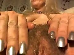 Blonde rubs out hairy pussy up close on cam