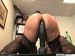 Ava Devine sitting on massive anal dildo and butt plug