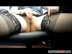 Woman maturbating in an office