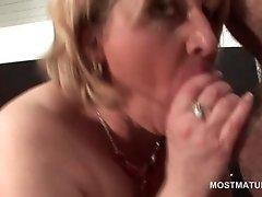 Blonde mature sucking dick for a cum shot