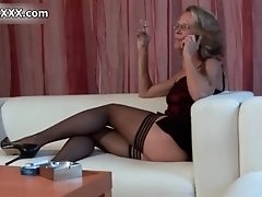 Nasty mature whore gets horny rubbing her wet cunt by a