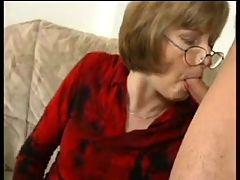 GRANNY AWARD 10 mature with a man on a sofa