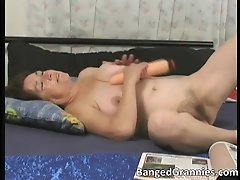 Filthy nasty horny woman fucking her wet twat with hard