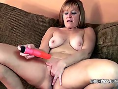 Mature blonde Liisa fucks her twat with a toy