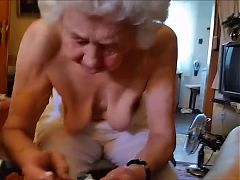 Old woman massaging dick