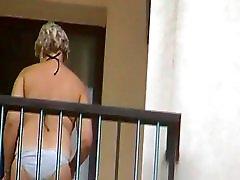 Neighbor smoking on balcony